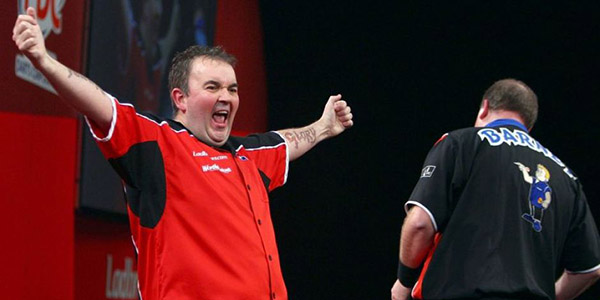 Phil Taylor celebrates defeating Raymond van Barneveld in 2009 World Championship Final (Lawrence Lustig, PDC)