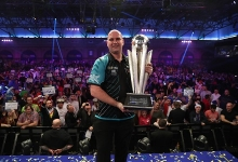 Rob Cross holding World Championship Trophy (Lawrence Lustig, PDC)